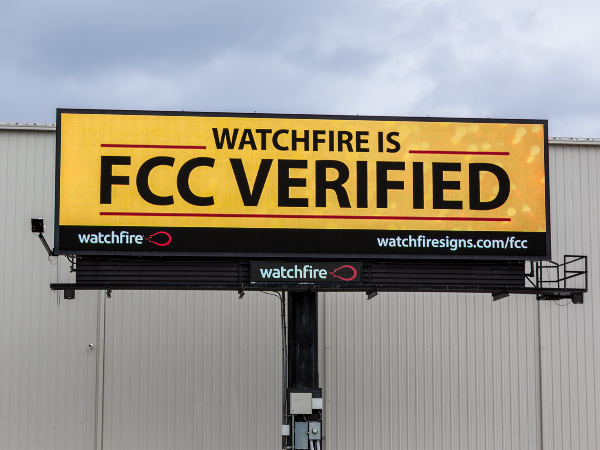 """Watchfire is FCC Verified"" message on company billboard."