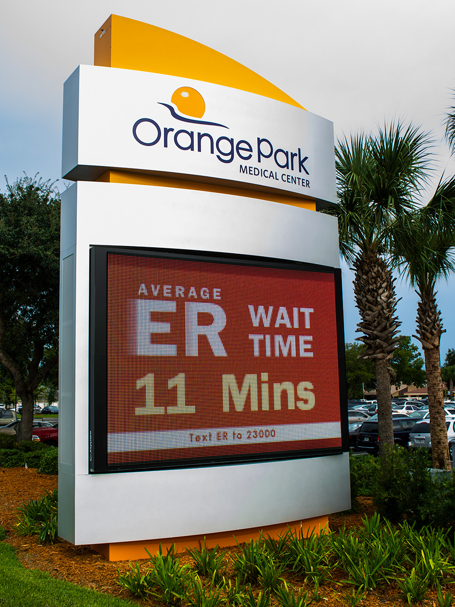 A Watchfire 16mm sign at Orange Park displaying ER wait times.