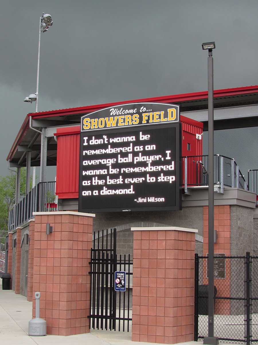 Rainy weather at Showers Field displaying a Watchfire LED sign.