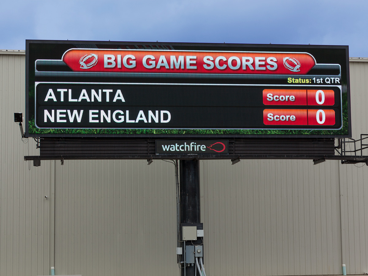 Pro Football scores shown on a digital billboard.