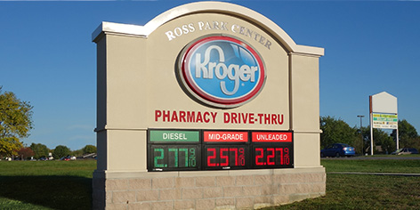 Kroger uses green and red gas price signs to digitally display gas prices.