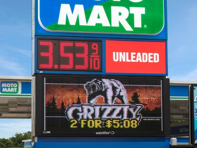 Some gas stations combine digital price signs with outdoor LED signs to attract customers.